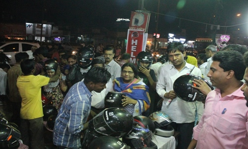 People rushed to buy helmets after State Government make helmet compulsory for two-wheeler riders along with p...