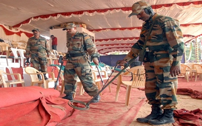 Security personnel sanitise the Field Marshal Manekshaw Parade Ground ahead of Republic Day parade in Bengalur...