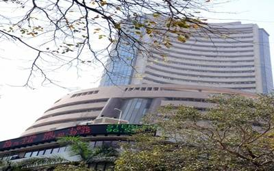 Equity indices end flat on weak global cues, trade tensions