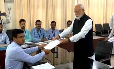 Modi files nomination from Varanasi, NDA stands in support (Lead)
