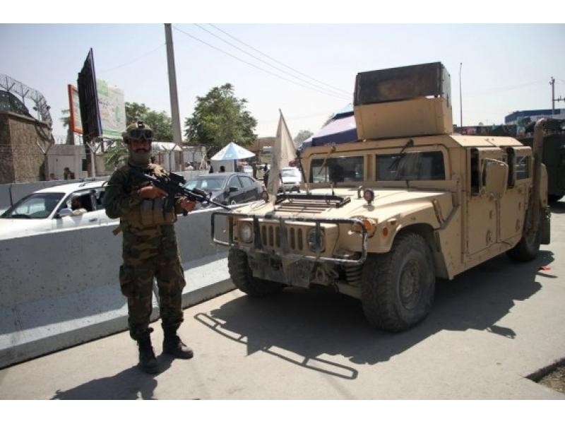 Taliban fighters force men into car boots